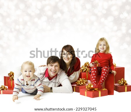 Christmas Family Portrait Over White Background, Kid and Baby With New Year Present Gift Box - stock photo