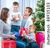 Christmas Family with Gifts - stock photo
