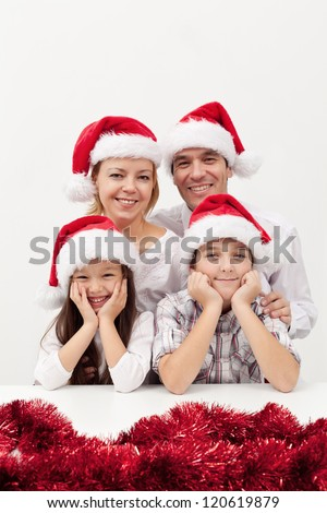 Christmas family with two kids together around holidays time - stock photo