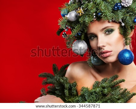 Christmas fashion model woman. Xmas New Year hairstyle and make up. Beauty Girl portrait. - stock photo