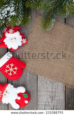 Christmas fir tree and decor on wooden table background with copy space - stock photo