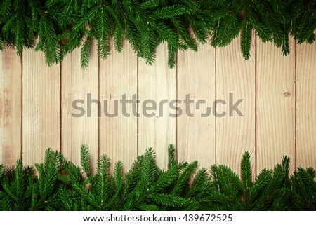 Christmas fir tree branch decorations on wooden background - stock photo