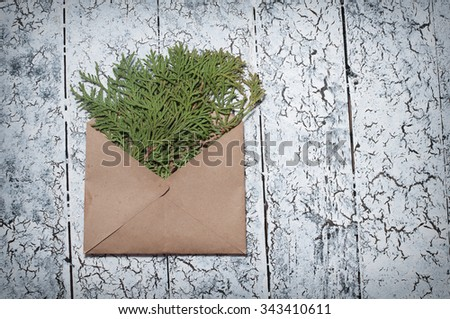 christmas fir tree, envelope on wooden background. - stock photo
