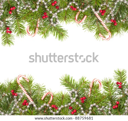 Christmas fir tree frame including baubles and candy canes with copy space - stock photo