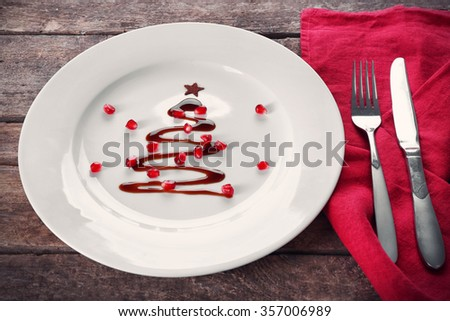 Christmas fir tree made from chocolate on plate, close up