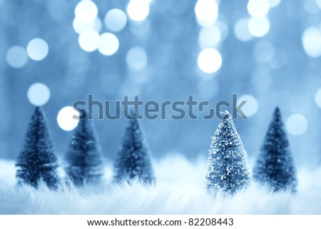 Christmas fir tree model on blurry background - stock photo