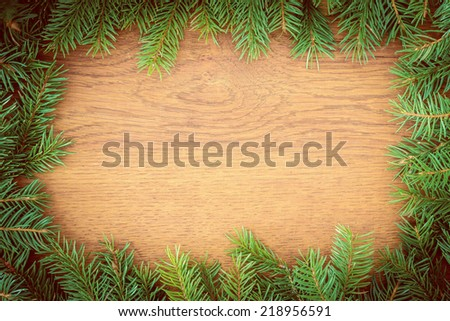 Christmas fir tree on a wooden board - stock photo