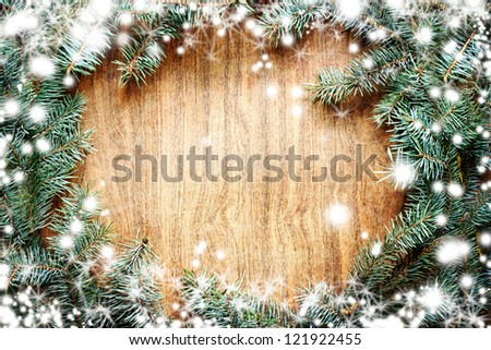 Christmas fir tree on a wooden board/Christmas green framework - stock photo
