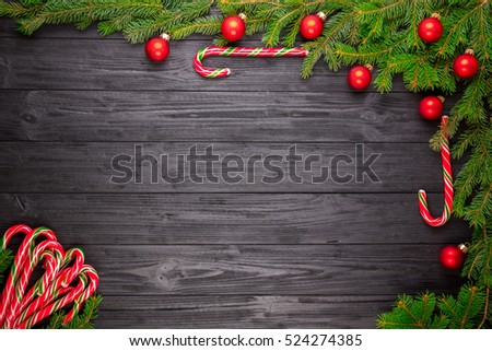 Christmas fir tree on black wooden grunge background