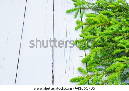 Christmas fir tree on blue white rustic wooden table. Green spruce branches. Xmas background or greeting card. Copy space for text - stock photo