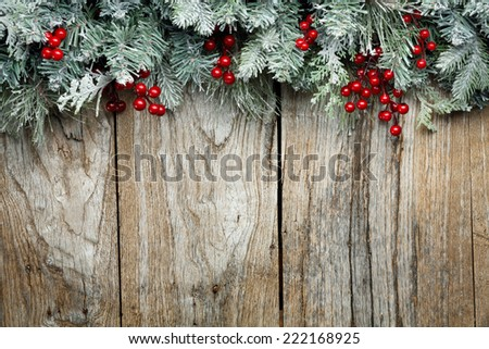 Christmas fir tree on grunge wooden background - stock photo