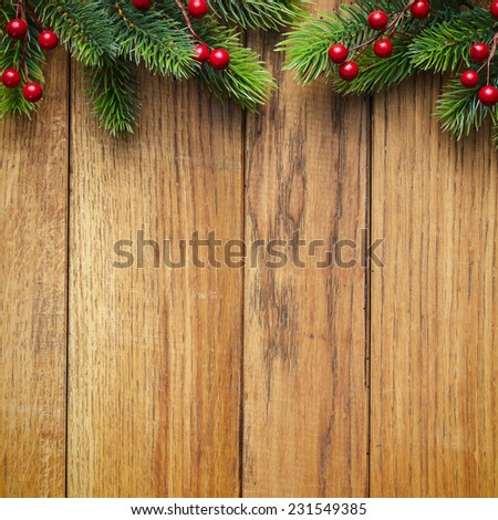 Christmas fir tree on the wooden board - stock photo