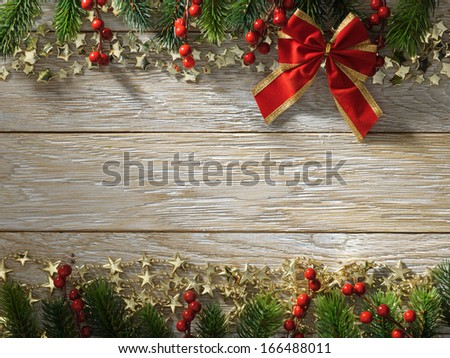 Christmas fir tree on wood texture with natural patterns background - stock photo
