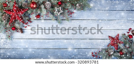 Christmas Fir Tree On Wooden Background With Snowflakes  - stock photo