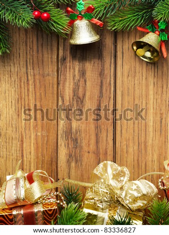 Christmas fir tree with christmas decoration on wooden board - stock photo