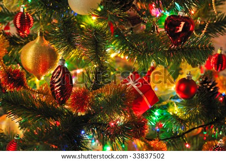 Christmas fir tree with colorful lights close up - stock photo