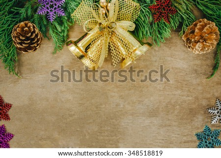 Christmas fir tree with cones and golden bell on a background, selective focus and place for text. Christmas.Christmas.Christmas.Christmas - stock photo