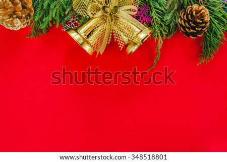 Christmas fir tree with cones and golden bell on a red background, selective focus and place for text. Christmas.Christmas.Christmas.Christmas - stock photo