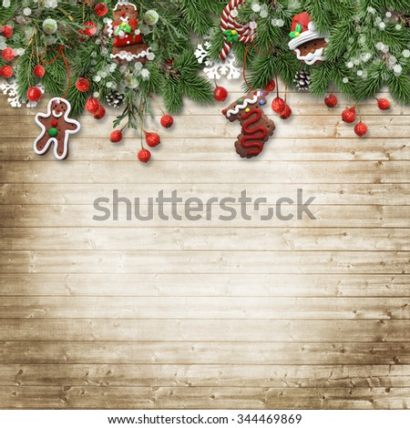Christmas fir tree with cookie,holly and decoration on wooden bo - stock photo