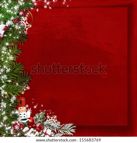 Christmas fir tree with nutcracker on a vintage red background - stock photo