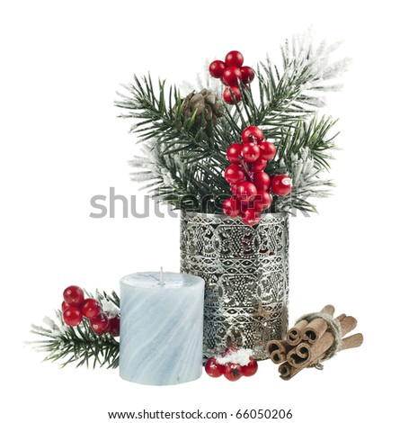 Christmas fir twigs with red berries, cinnamon and candle - stock photo