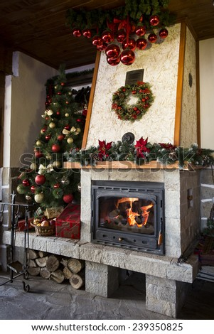 Christmas fireplace with decorated christmas tree - stock photo