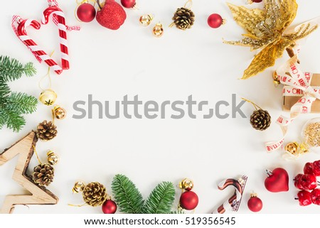 Christmas flat lay styled scene - frame with evergreen tree twigs and decorations