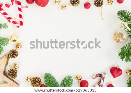 Christmas flat lay styled scene - top view frame with evergreen tree twigs and decorations