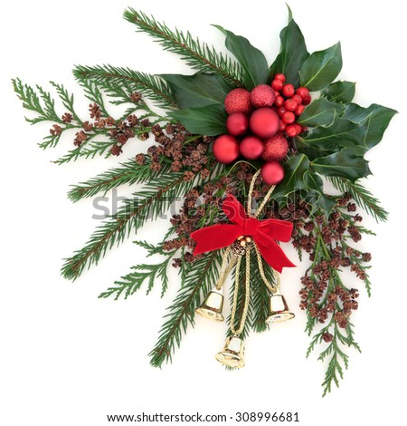 Christmas flora with gold bells and red bauble decorations with holly, ivy and winter greenery over white background. - stock photo