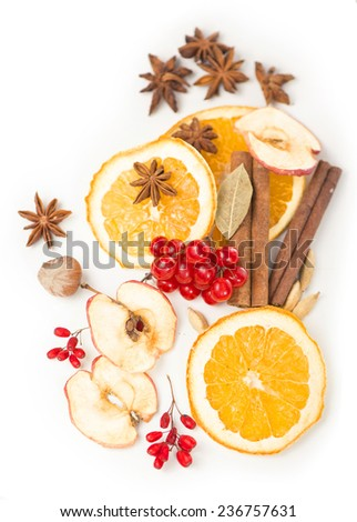 Christmas frame. Christmas spices and dried orange sliceson  - stock photo