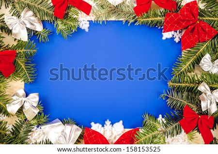 Christmas frame for congratulations and blue paper - stock photo