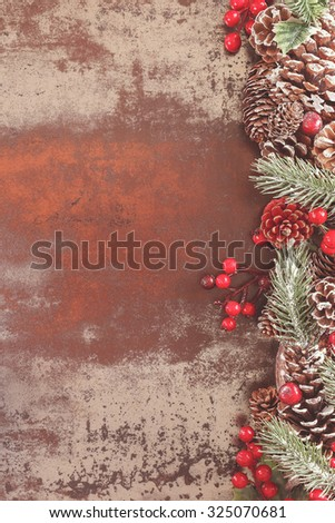 Christmas frame. Holiday frame with Christmas tree branches and decorations on rustic background with copy space - stock photo