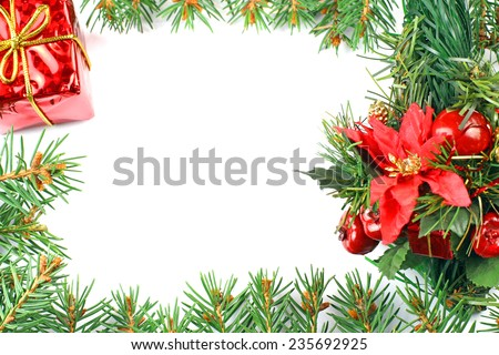 christmas frame of the branches of spruce on a white background - stock photo