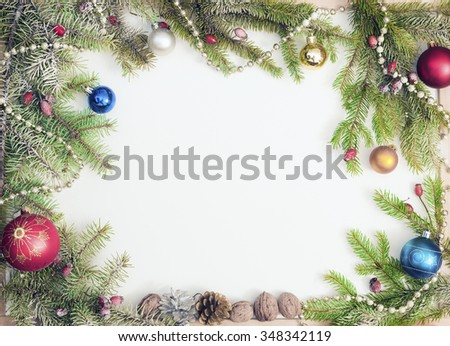 Christmas frame with Christmas ornaments and decorations.White. - stock photo