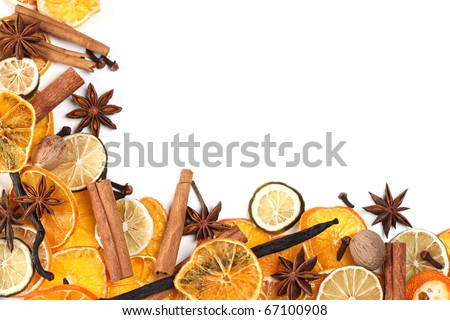 Christmas frame with Christmas spices and dried orange slices isolated on white background - stock photo