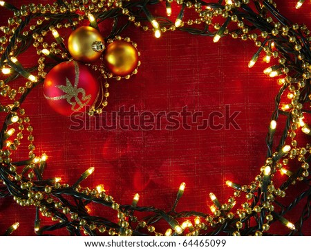 Christmas frame with decorative lights and red and yellow balls - stock photo