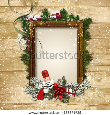 Christmas frame with the decor and the Nutcracker on a wooden ba - stock photo