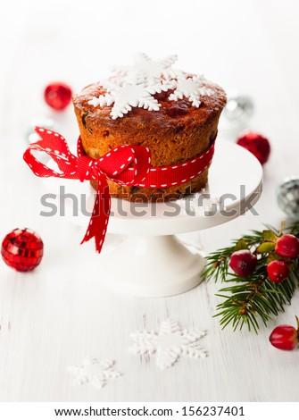 Christmas fruit cake  with sugar snowflakes - stock photo