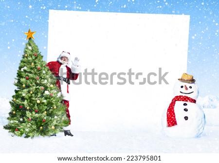 Christmas fun with placard on winter. - stock photo