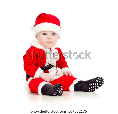 Christmas funny baby in Santa Claus clothes - stock photo