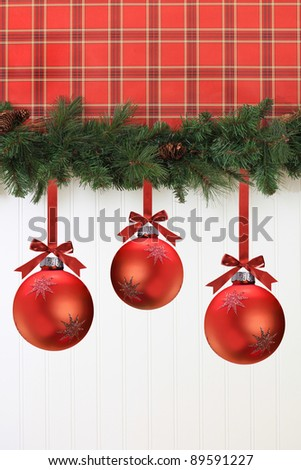 Christmas garland and decorations hanging on the wall. - stock photo