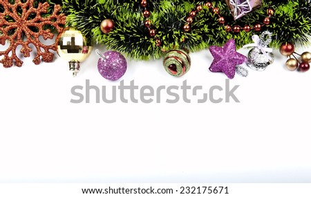Christmas garland. Composition with colored balls, golden decorations, green tinsel. festive arrangement with place for your text. - stock photo
