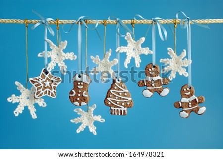Christmas garland decorated gingerbread  and crocheted snowflakes. - stock photo