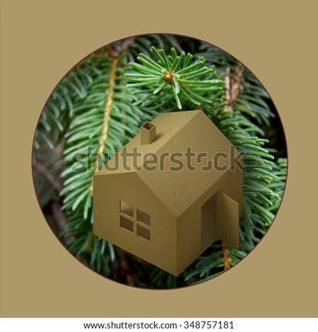 Christmas garland house. Garland to decorate a Christmas tree in a small cardboard toy house. - stock photo