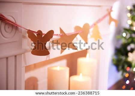 Christmas garland near fireplace close-up - stock photo