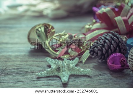 Christmas garland on rustic wooden background with copy space, retro style toned picture - stock photo
