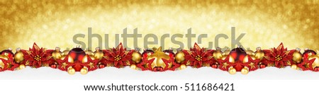 christmas garland super wide panorama banner with sparkle shiny glitter golden background and red gold christmas decoration baubles balls stars snow
