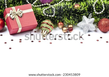 christmas garland with colored balls, decorations, green tinsel. festive arrangement with place for your text  - stock photo