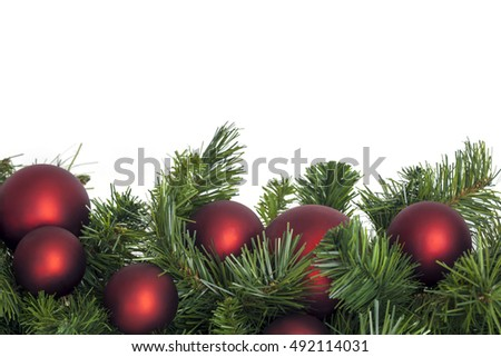 Christmas garland with red baubles.  Border over white background.