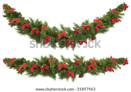 Christmas garlands decorated with red velvet bows, isolated on white.  One garland is straight, and the other curved. - stock photo